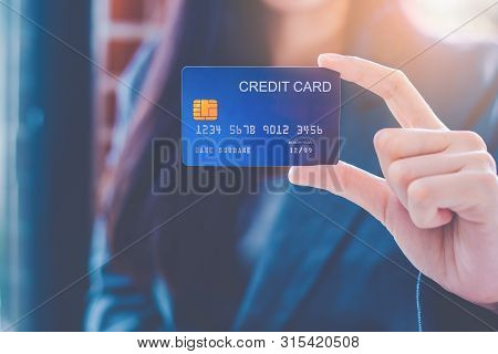 Business Women Hand Are Showing A Blue Credit Card.