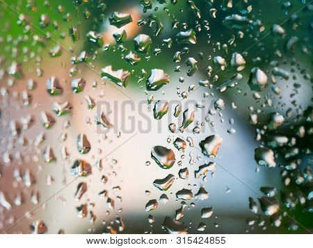 Wet Window Glass With Raindrops After Summer Rain