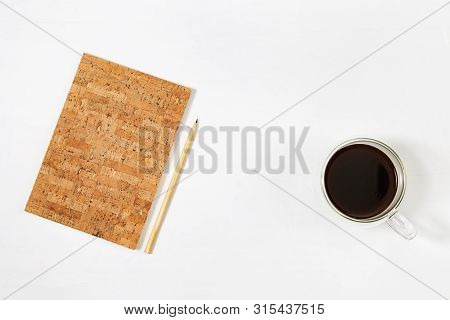 Closed Notebook With Cover Made Of Wood Cork And Pencil For Drawing Or Sketching, Cup Of Coffee On W