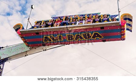 Sarina, Queensland, Australia - August 2019: People Enjoying A High And Fast Thrill Ride At Sarina L