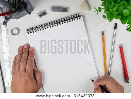 Human Hand With Pencil Prepare To Writing On Notebook