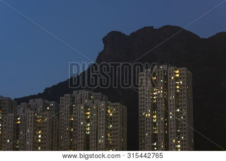 Reisdential Building Under Lion Rock In Hong Kong City At Night