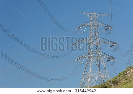 Electric Pylon With Electric Line On Hill Top
