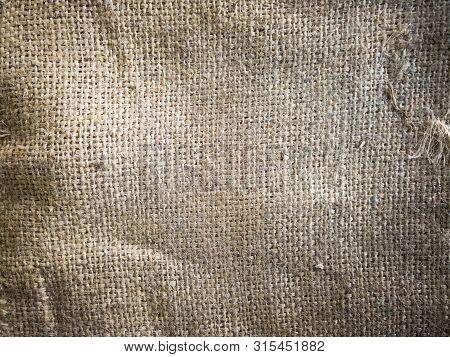 Close-up Fabric Linen Texture, Sackcloth Nature Texture.brown Background.