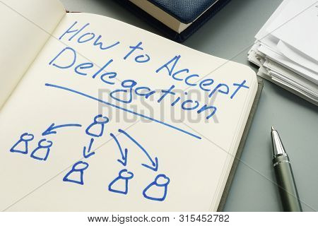 How To Accept Delegation. Note Pad And Pen.