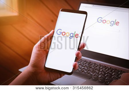 Bangkok, Thailand - August 5, 2019: Woman Hands Holding Smartphone With Google Logo On Screen And Go