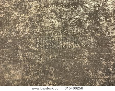 Texture Of Brown Wallpaper With A Curly Glossy Pattern. Golden Paper Surface, Structure Closeup.