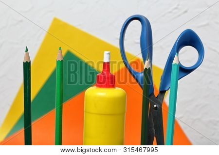 Color Pencils In Green Shades. Scissors, Glue And Colored Paper For Application. They Are Located Ve