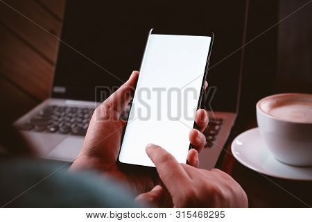 Mockup Mobile Phone Image. Close Up Hands Using Modern Smart Phone Technology In Coffee Shop With Bl