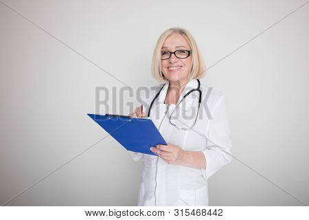 Woman Doctor With Stethoscope And Blue Tablet Standing Isolated.