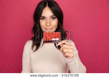 Advertising Concept. Lady Smiling And Showing Credit Card Isolated.
