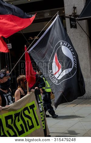 The Antifa Flag Being Displayed At An Anti Fascist Demonstration In Opposition To A Rally By Support