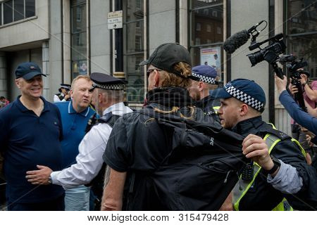 London, United Kingdom, August 3rd 2019:- Police Intervene Prevent Tommy Robinson Supporters And Ant