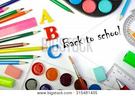 Back To School. School Supplies. Pencils, Paints, Eraser, Pens, Brushes And Letters On A White Backg