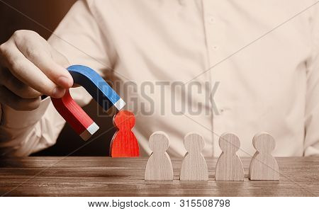 The Businessman Draws A Red Figure From The Team With A Magnet. Increase Team Efficiency And Product