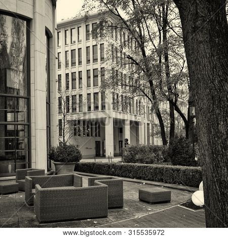 Patio And An Exterior Of A Building With A Restaurant. Outdoor Chairs. Black White Photography. Germ
