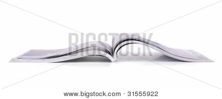 Panoramic shot of open magazine isolated on white poster