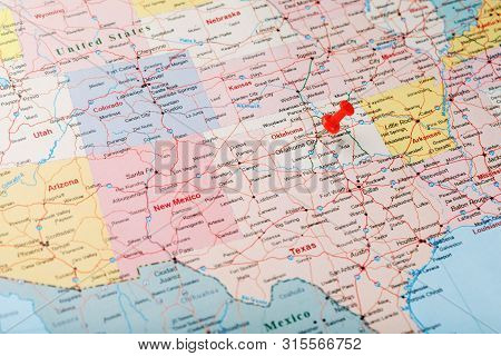 Red Clerical Needle On A Map Of The Usa, Oklahoma And The Capital Of Oklahoma City. Close Up Map Of