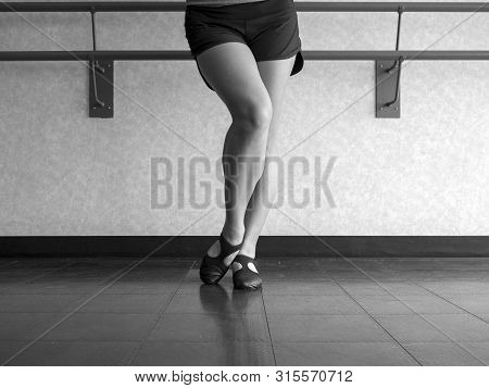 Black And White Version Of Dancer With Bevelled Foot In Jazz Dig Position