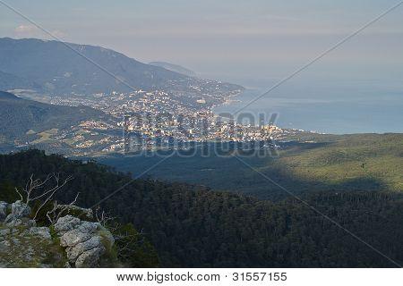 City On Seacoast Under Mountains
