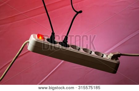 Bucharest, Romania - November 07, 2018: An Electric Extension Cord With Two Wires Connected Is Switc