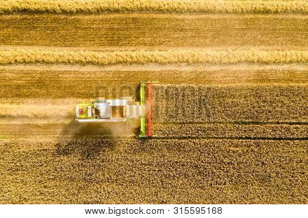 Harvesting Time. Agriculture. Agricultural Industry. Aerial View Of Combine Harvester In Field. Agri