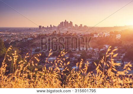 Los Angeles city center at sunset. Financial part of city with skyscrapers, most famous and iconic part of LA