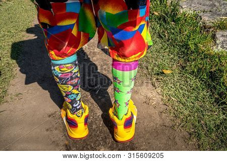 Man With Multicolor Clothing, Socks And Sneakers