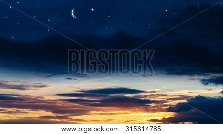 Crescent Moon With Beautiful Sunset Background . Generous Ramadan . New Moon. Prayer Time.