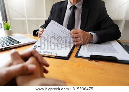 A Young Female Business Women Applicant In Office Male Manager Interviewing Holding Resume And Speak