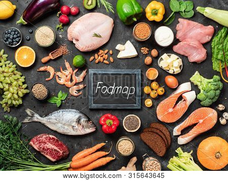 Fodmap Diet Concept. Low Fodmap Ingredients - Poultry Meat, Fish, Seafood, Vegetables And Fruits And