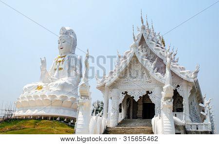Statue Of Guan Yin Beside White Temple