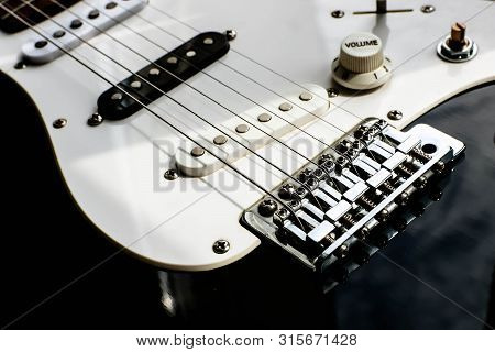 Black And White Electronic Guitar Close Up View. Details Of Rock Guitar.