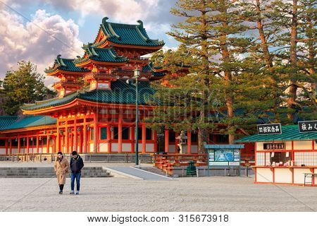 KYOTO, JAPAN, APRIL 02, 2019 : A tourist couple is walking in the courtyard of the Heian jingu temple.