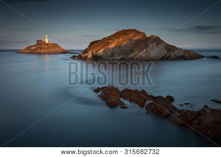 Mumbles Lighthouse At Dusk A Long Exposure At Dusk Of The Landmark That Is Mumbles Lighthouse On The