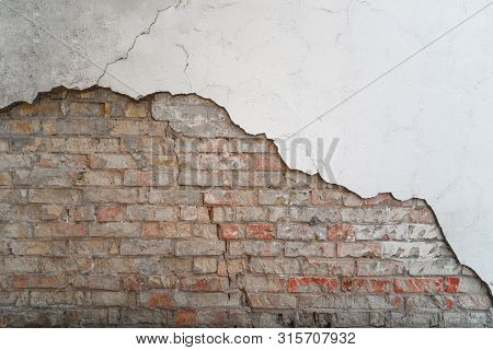 Old Wall Of Bricks With Chapped Plasterwork. Abstract Background With Empty Space For Your Design.