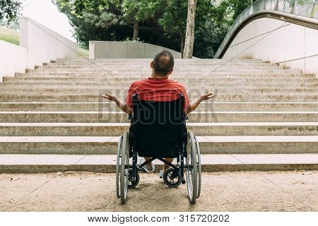 Man In Wheelchair Outraged In Front Of Stairs