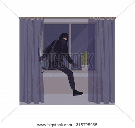 Male Burglar Wearing Mask And Hoodie Breaking In House Or Apartment. Theft, Burglary Or Housebreakin