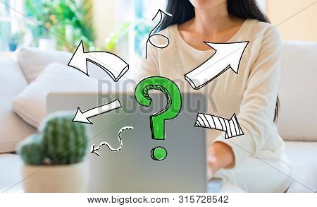 Question Mark With Arrows With Woman Using Her Laptop In Her Home Office