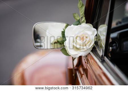 Wedding Rose Decoration At The Quarter Glass Of An Old Car