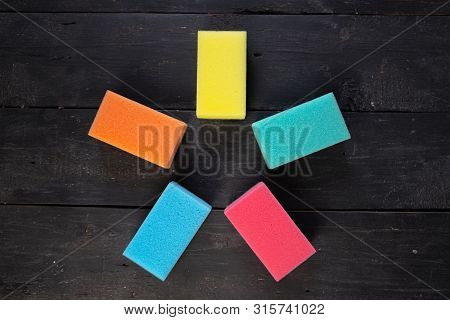 Sponges Form A Pentagon Star Shape, Top View. Five Pieces Of Dishcloth On Dark Background, Shot From