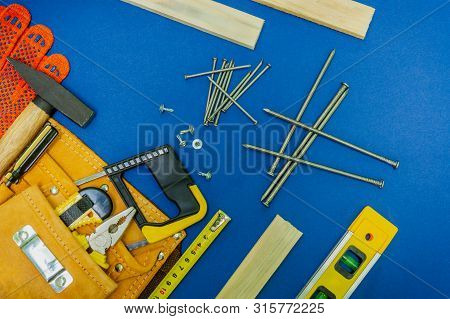 Professional tools for the joiner and spare parts.. Set for the master on blue background. poster