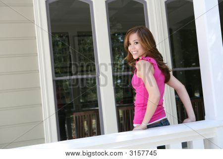 Teenager At Home On The Proch