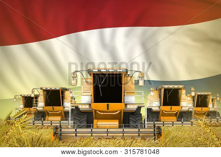 Some Yellow Farming Combine Harvesters On Grain Field With Netherlands Flag Background - Front View,