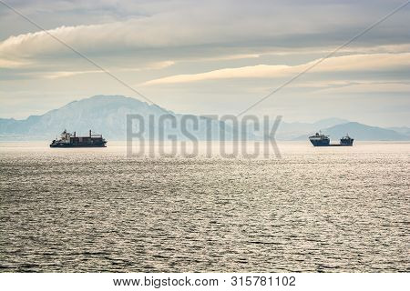 Algeciras, Spain - October 22, 2013. Boats Sailing In Strait Of Gibraltar Near Moroccan Coast