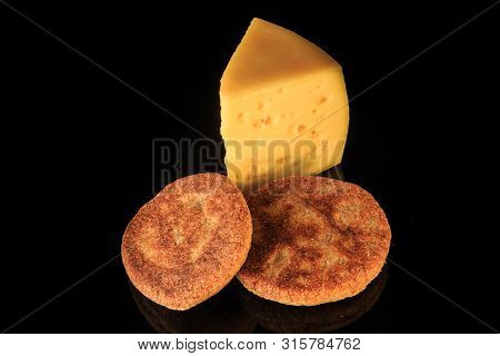 Top View Of Hard Yellow Cheese Piece With Two Rye Flapjacks
