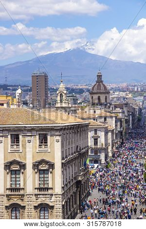 Catania, Italy - May 8, 2018: People Walk On Via Etnea Central Street Of Catania With The View On Et