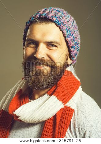 Men Winter Fashion. Handsome Man Wearing Scarf, Hat, Jacket. Casual Look. Trendy Man In Cap. Men's C