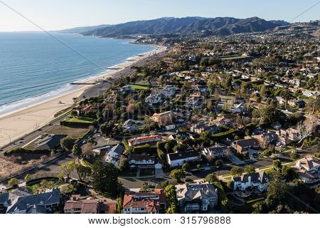 Aerial view of scenic ocean view Pacific Palisades homes and streets in Los Angeles, California.
