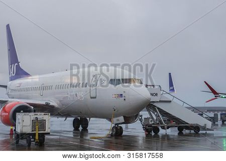 Oslo / Norway - 10 December 2018: Sas Airlines Arrived At Oslo Airport In Stormy Day